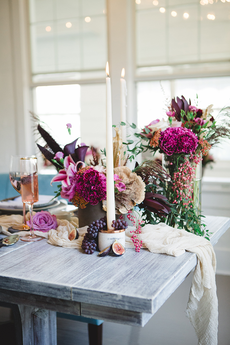 wedding tablescapes with fuchsia flowers - https://ruffledblog.com/fall-wedding-tablescape-with-an-unexpected-color-palette