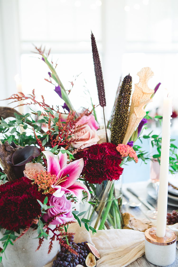 tropical inspired wedding flowers - https://ruffledblog.com/fall-wedding-tablescape-with-an-unexpected-color-palette