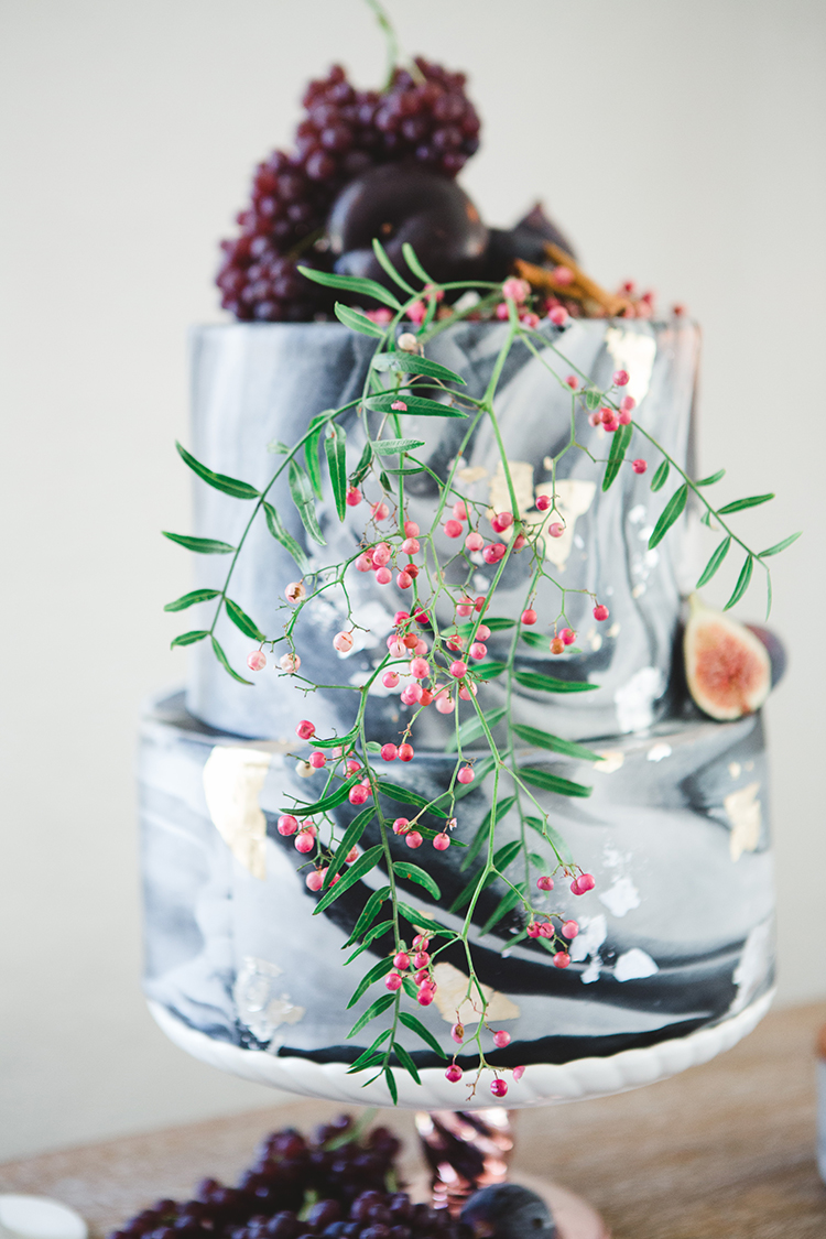 grey marbled wedding cakes - https://ruffledblog.com/fall-wedding-tablescape-with-an-unexpected-color-palette