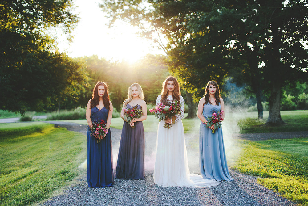 blue bridesmaid dresses - photo by Shots by Cheyenne http://ruffledblog.com/farm-to-table-wedding-inspiration-in-nashville