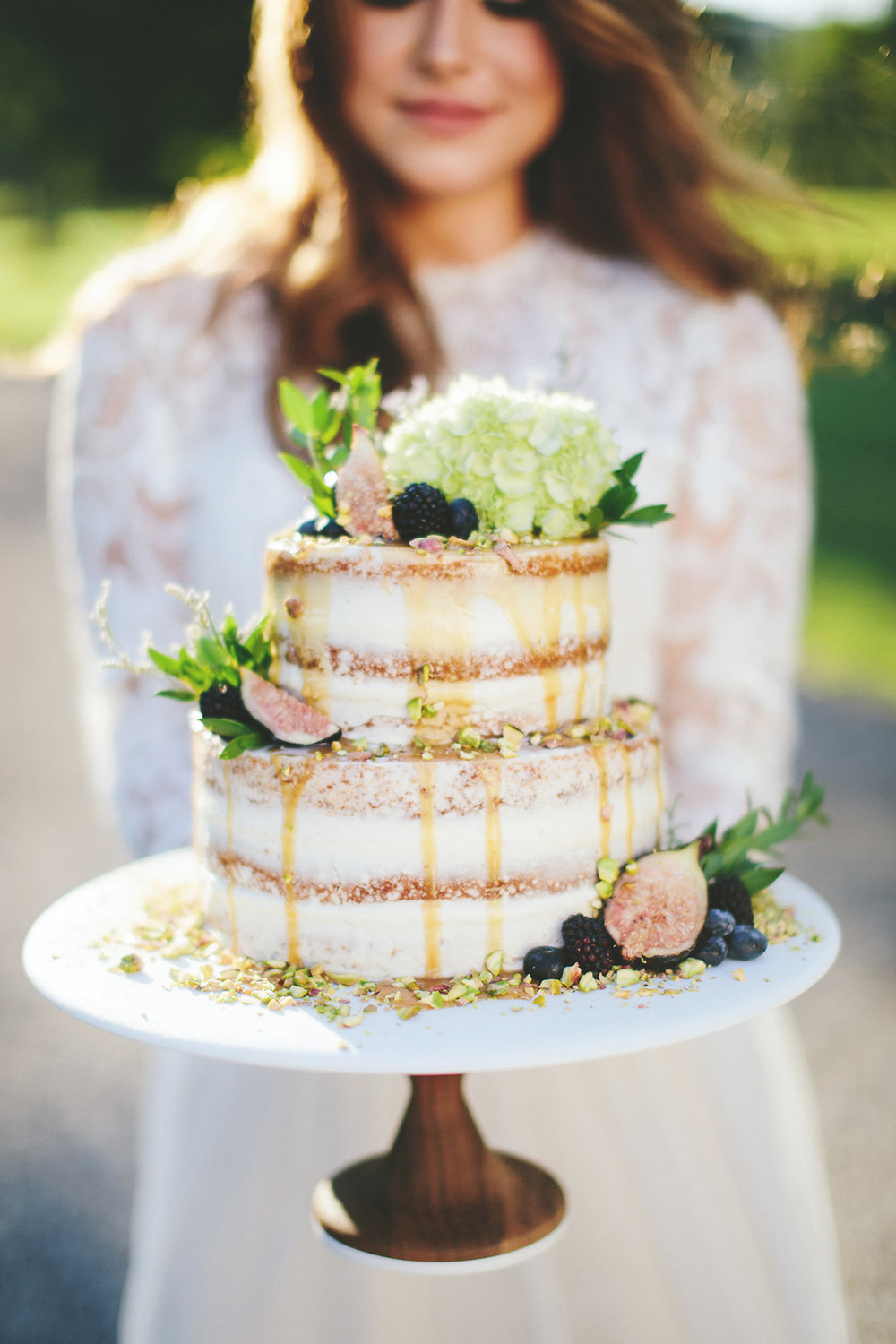 lightly iced wedding cakes with figs - photo by Shots by Cheyenne http://ruffledblog.com/farm-to-table-wedding-inspiration-in-nashville