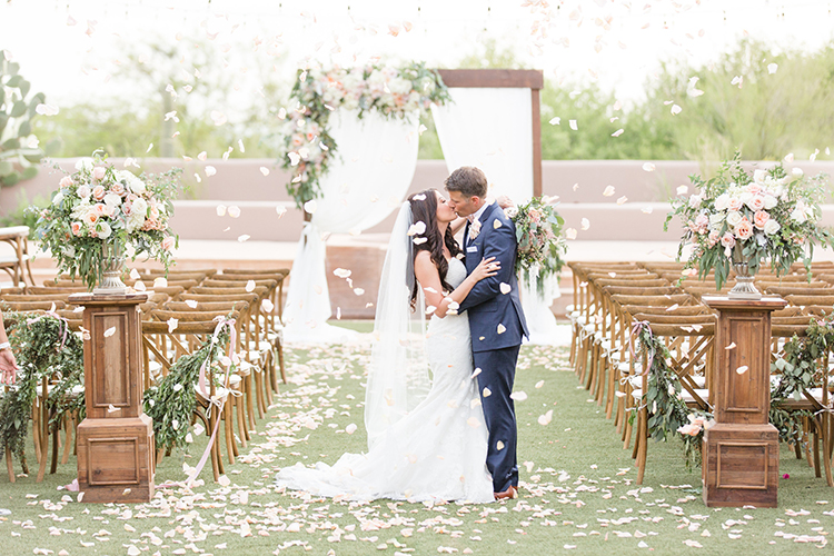 Feminine Floral Wedding in the Arizona Desert - photo by Amy and Jordan Photography http://ruffledblog.com/feminine-floral-wedding-in-the-arizona-desert