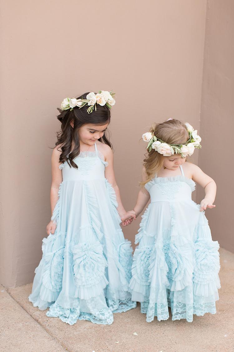 blue flower girl dresses - photo by Amy and Jordan Photography http://ruffledblog.com/feminine-floral-wedding-in-the-arizona-desert