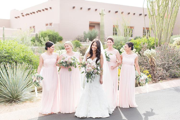 wedding parties in blush pink - photo by Amy and Jordan Photography http://ruffledblog.com/feminine-floral-wedding-in-the-arizona-desert