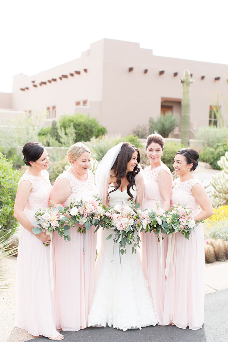 blush pink bridesmaid dresses - photo by Amy and Jordan Photography https://ruffledblog.com/feminine-floral-wedding-in-the-arizona-desert