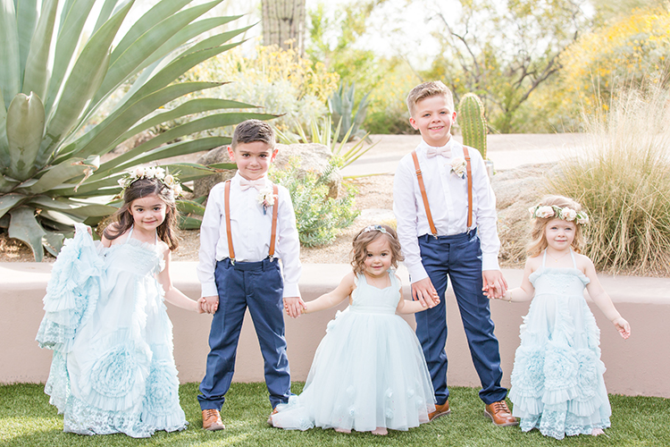 flower girls and ring bearers - photo by Amy and Jordan Photography https://ruffledblog.com/feminine-floral-wedding-in-the-arizona-desert