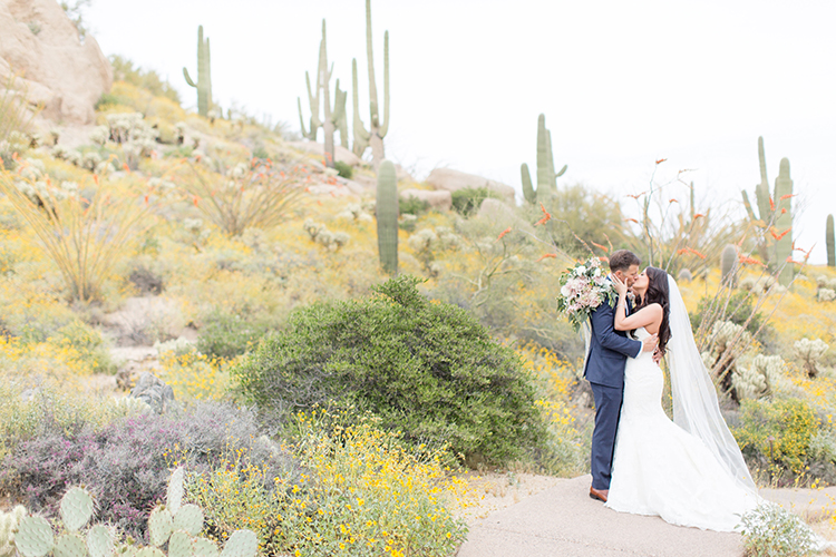 wedding photography - photo by Amy and Jordan Photography https://ruffledblog.com/feminine-floral-wedding-in-the-arizona-desert
