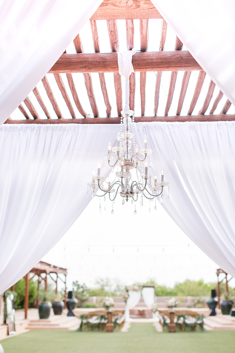 romantic wedding ceremony setups - photo by Amy and Jordan Photography https://ruffledblog.com/feminine-floral-wedding-in-the-arizona-desert