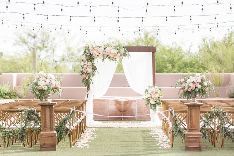 romantic feminine wedding ceremonies - photo by Amy and Jordan Photography https://ruffledblog.com/feminine-floral-wedding-in-the-arizona-desert