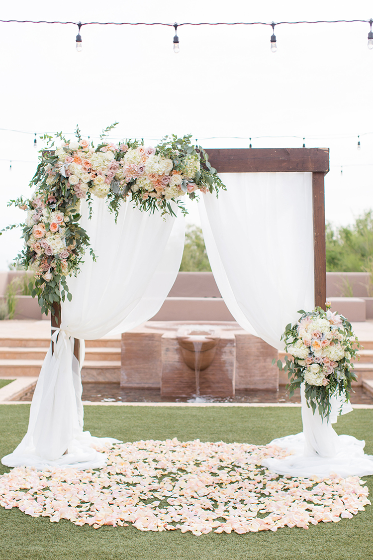 romantic floral wedding ceremonies - photo by Amy and Jordan Photography https://ruffledblog.com/feminine-floral-wedding-in-the-arizona-desert