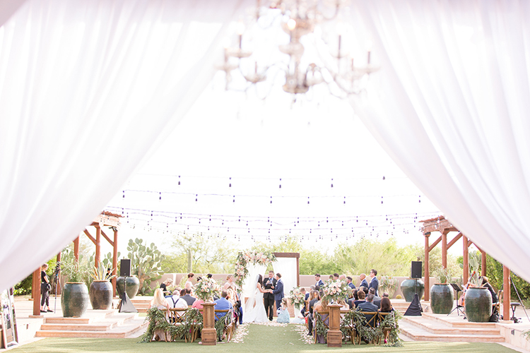 wedding ceremonies - photo by Amy and Jordan Photography https://ruffledblog.com/feminine-floral-wedding-in-the-arizona-desert
