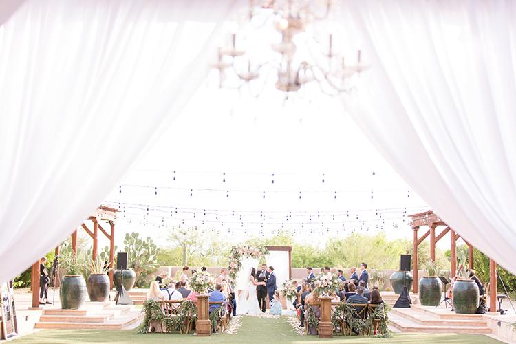 wedding ceremonies - photo by Amy and Jordan Photography http://ruffledblog.com/feminine-floral-wedding-in-the-arizona-desert