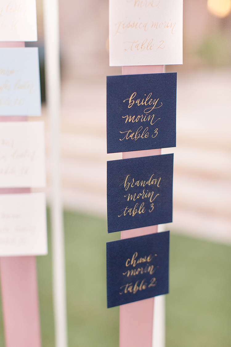 ribbon seating charts - photo by Amy and Jordan Photography https://ruffledblog.com/feminine-floral-wedding-in-the-arizona-desert