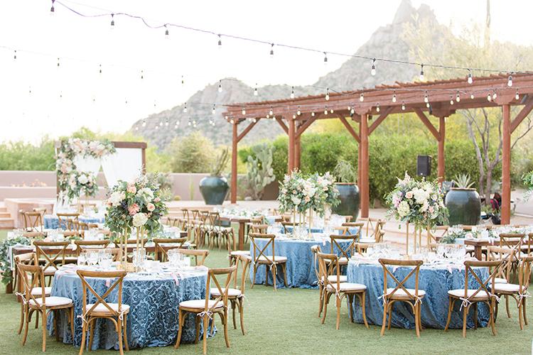 blue wedding receptions - photo by Amy and Jordan Photography http://ruffledblog.com/feminine-floral-wedding-in-the-arizona-desert