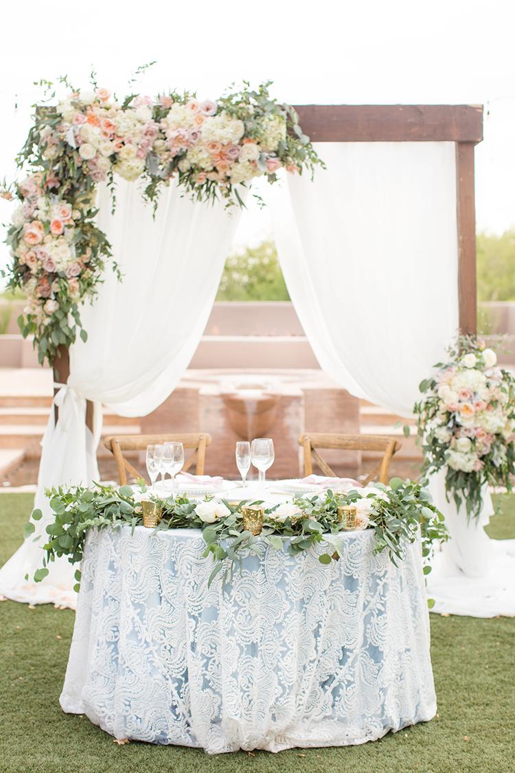 romantic wedding sweetheart tables - photo by Amy and Jordan Photography http://ruffledblog.com/feminine-floral-wedding-in-the-arizona-desert