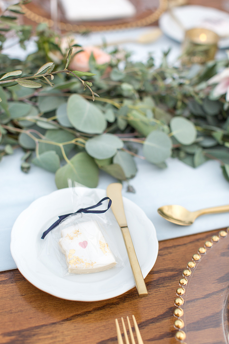 wedding tablescapes with eucalyptus - photo by Amy and Jordan Photography https://ruffledblog.com/feminine-floral-wedding-in-the-arizona-desert