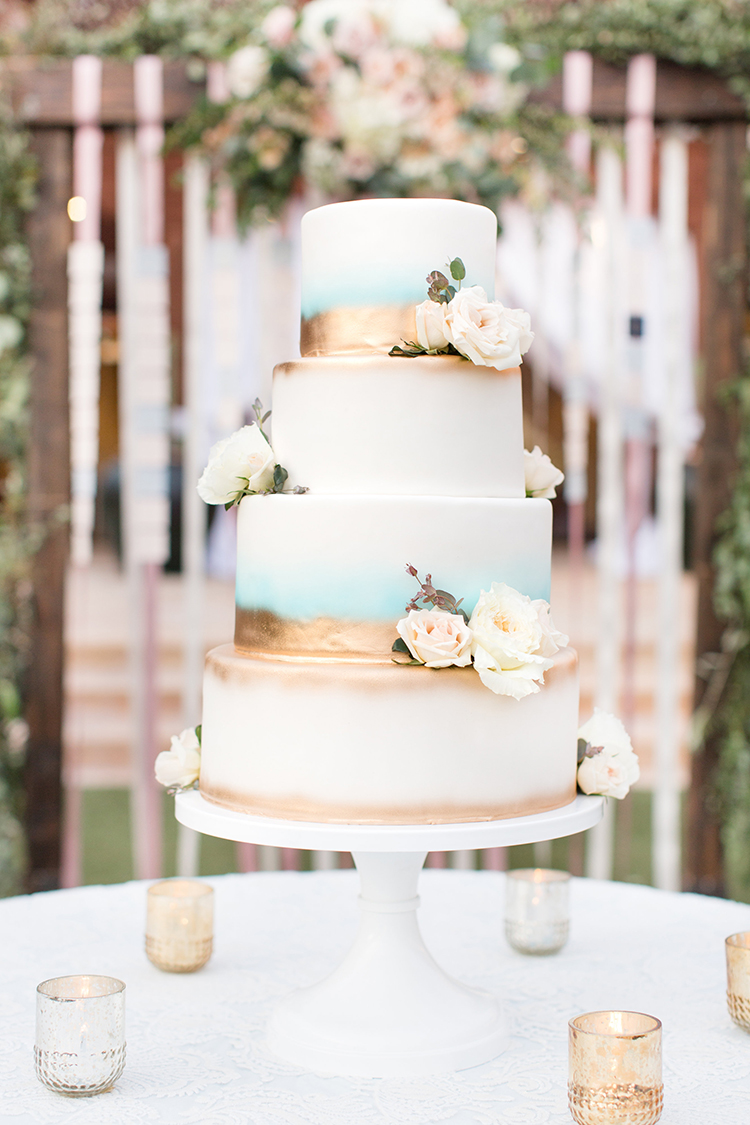 blue and gold wedding cakes - photo by Amy and Jordan Photography https://ruffledblog.com/feminine-floral-wedding-in-the-arizona-desert