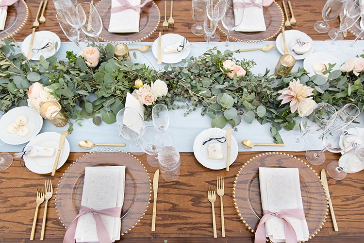 wedding tables with eucalyptus - photo by Amy and Jordan Photography http://ruffledblog.com/feminine-floral-wedding-in-the-arizona-desert