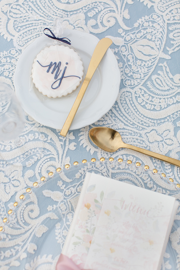 blue and gold wedding details - photo by Amy and Jordan Photography https://ruffledblog.com/feminine-floral-wedding-in-the-arizona-desert
