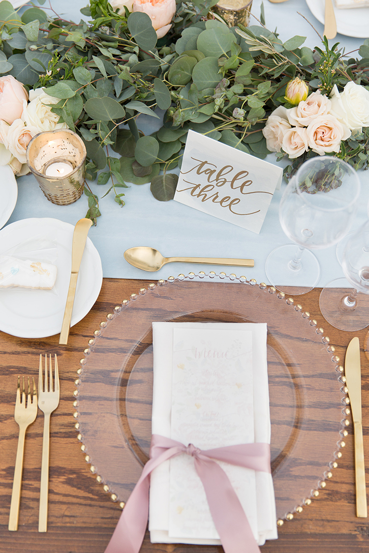 romantic glam place settings - photo by Amy and Jordan Photography https://ruffledblog.com/feminine-floral-wedding-in-the-arizona-desert