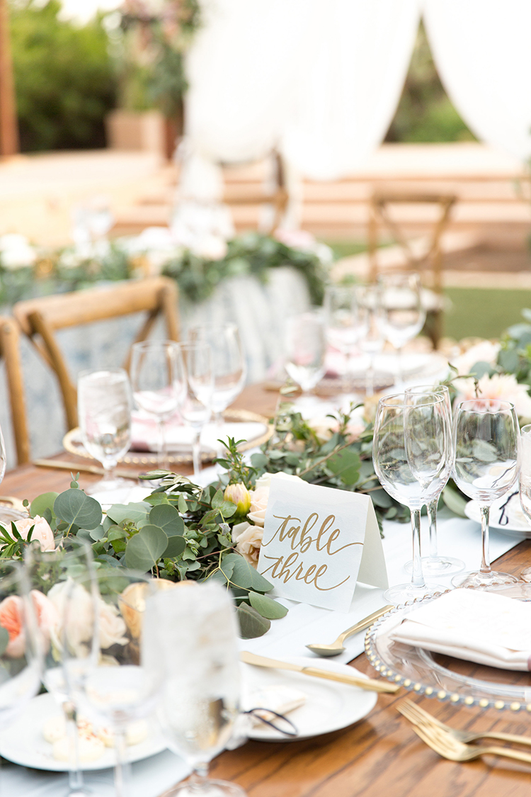 eucalyptus table runners - photo by Amy and Jordan Photography https://ruffledblog.com/feminine-floral-wedding-in-the-arizona-desert