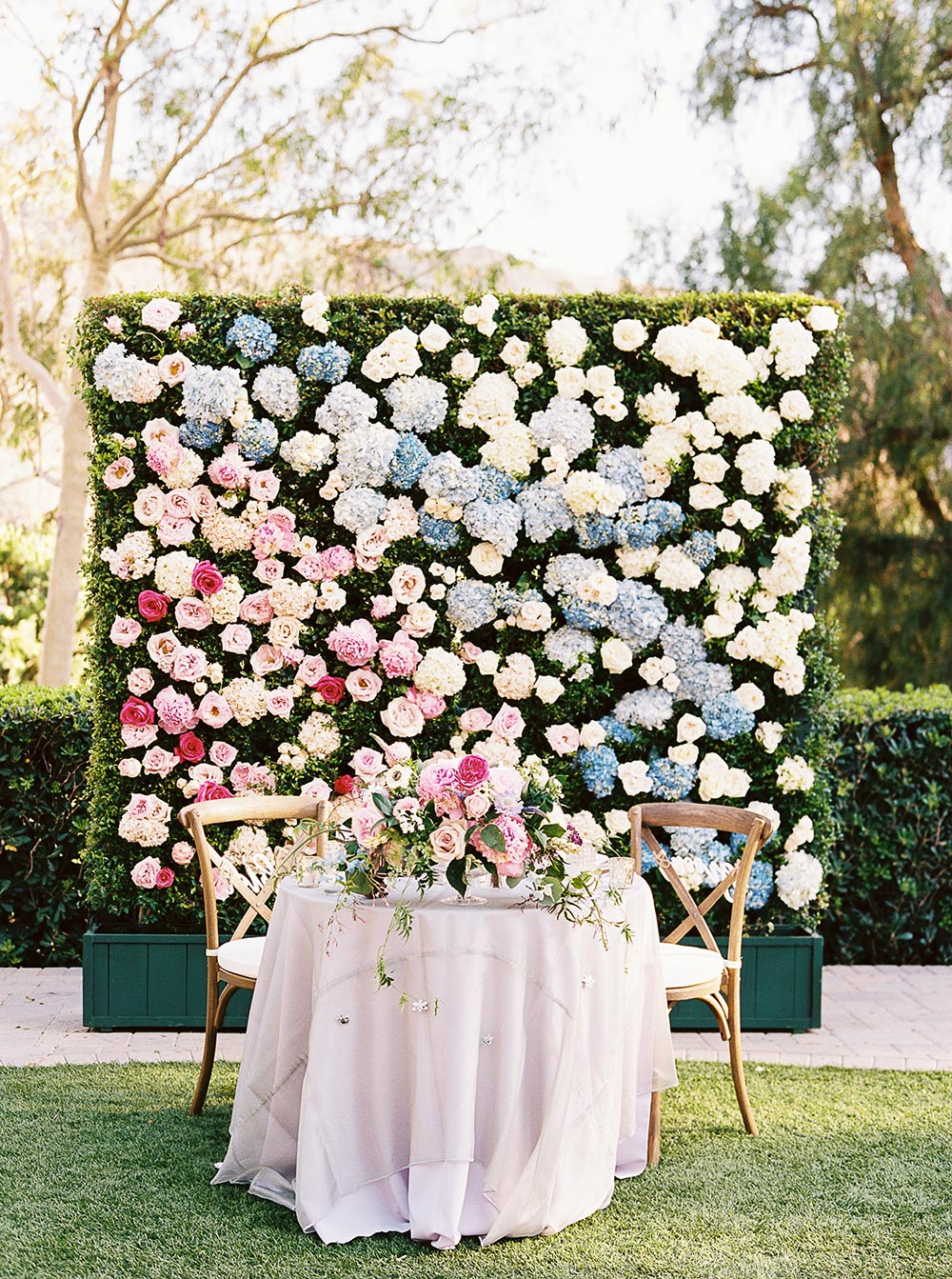 Crazy in love with this firefly inspired garden wedding ruffled colorful flower wall wedding backdrop sweetheart table garden wedding solutioingenieria Image collections