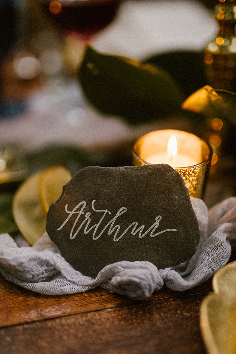 rock place cards - photo by Victoria Selman https://ruffledblog.com/foggy-mountaintop-elopement-inspiration-with-macrame