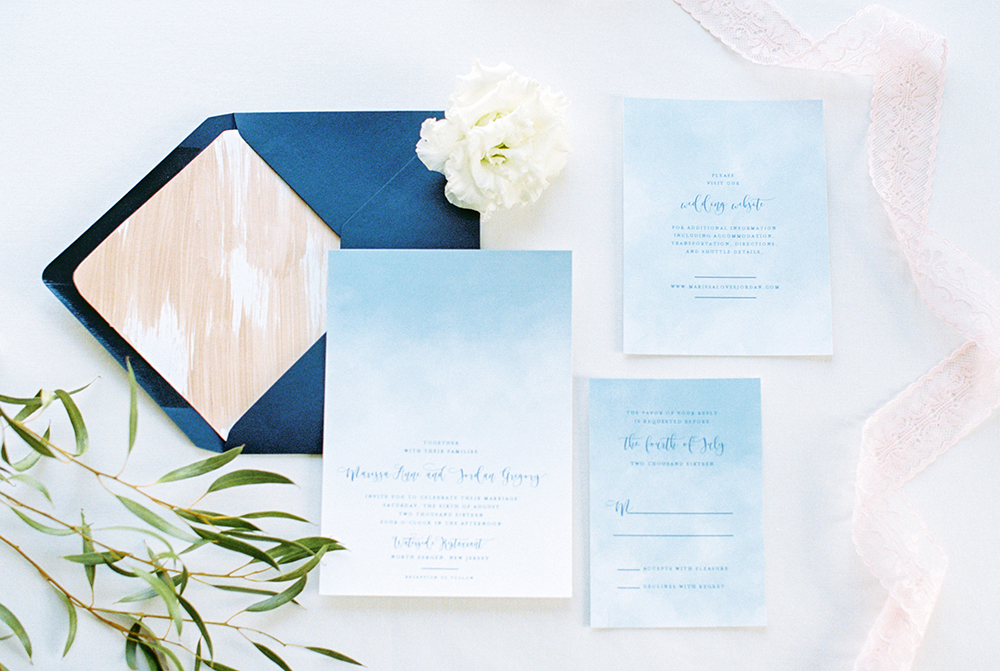 blue wedding invitations - photo by Alexis June Weddings https://ruffledblog.com/for-the-love-of-copper-wedding-inspiration