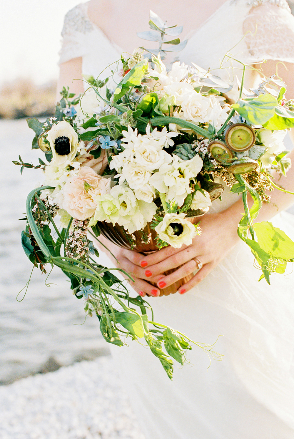 anemone wedding bouquets - photo by Alexis June Weddings http://ruffledblog.com/for-the-love-of-copper-wedding-inspiration