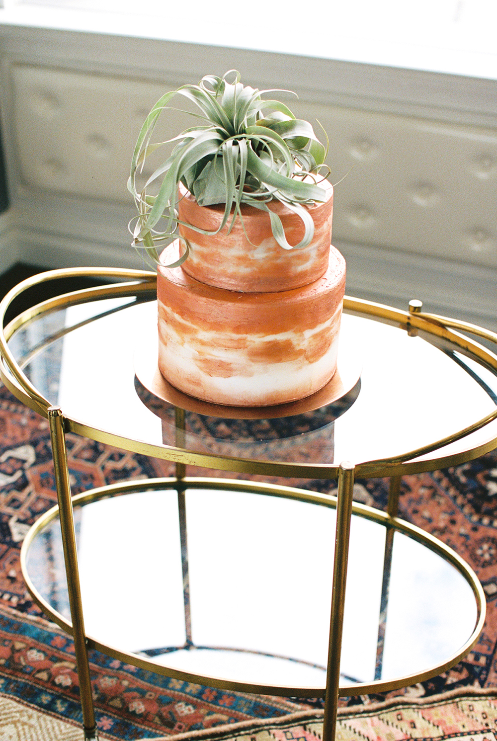 copper wedding cakes - photo by Alexis June Weddings http://ruffledblog.com/for-the-love-of-copper-wedding-inspiration