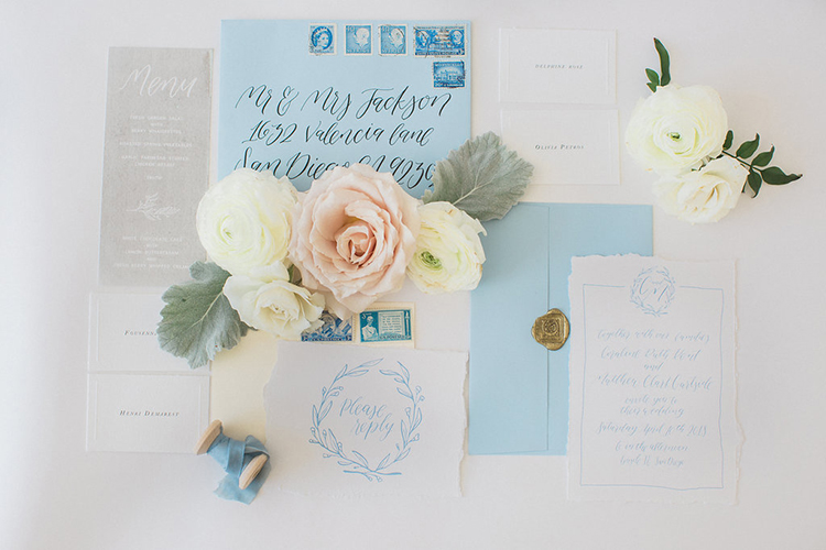 blue wedding invitations - photo by Natalie Bray Photography https://ruffledblog.com/french-provencal-wedding-inspiration-with-geometric-accents