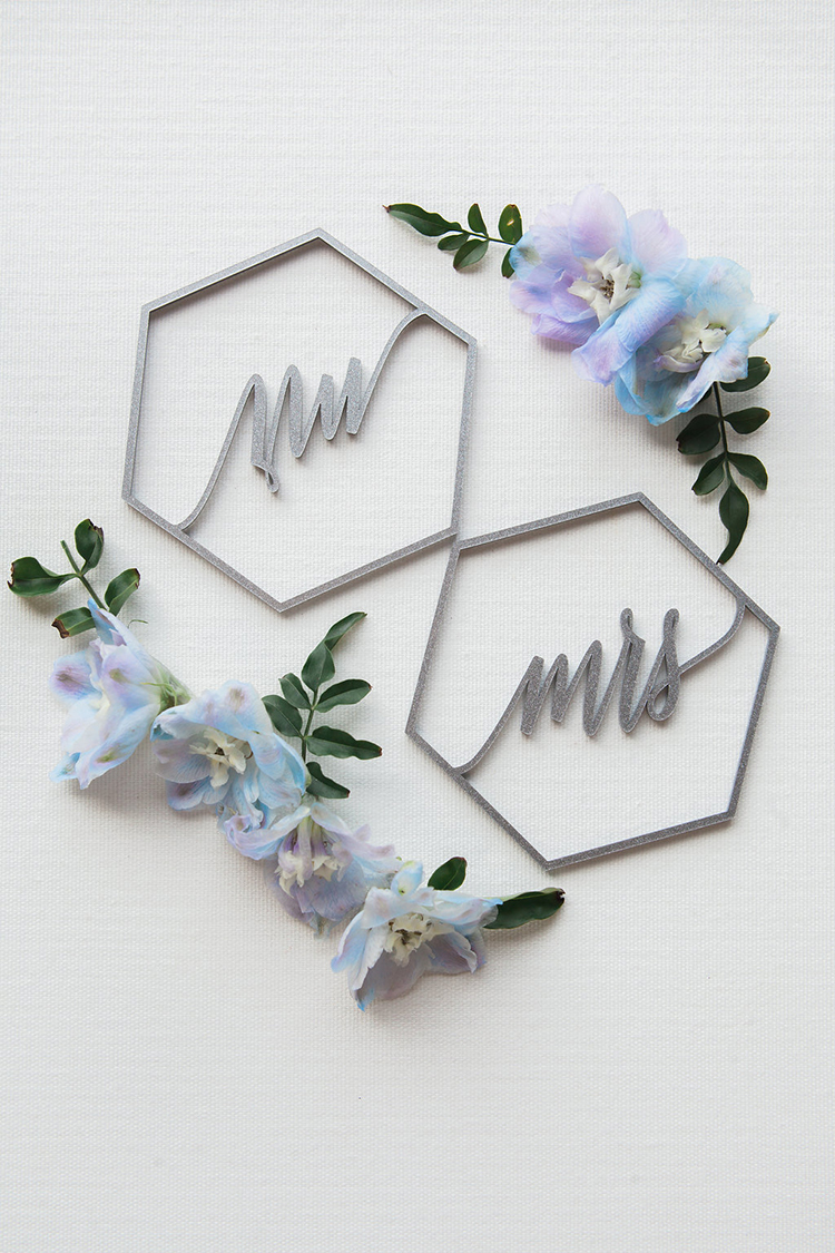 laser cut wedding place cards - photo by Natalie Bray Photography https://ruffledblog.com/french-provencal-wedding-inspiration-with-geometric-accents