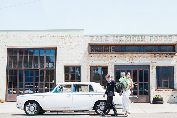 vintage ewdding cars - photo by Natalie Bray Photography https://ruffledblog.com/french-provencal-wedding-inspiration-with-geometric-accents