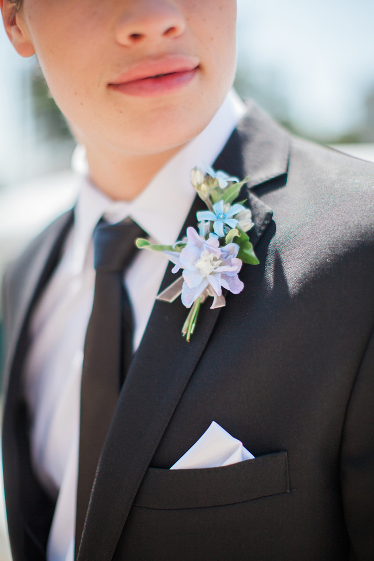 simple purple and blue boutonnieres - photo by Natalie Bray Photography https://ruffledblog.com/french-provencal-wedding-inspiration-with-geometric-accents