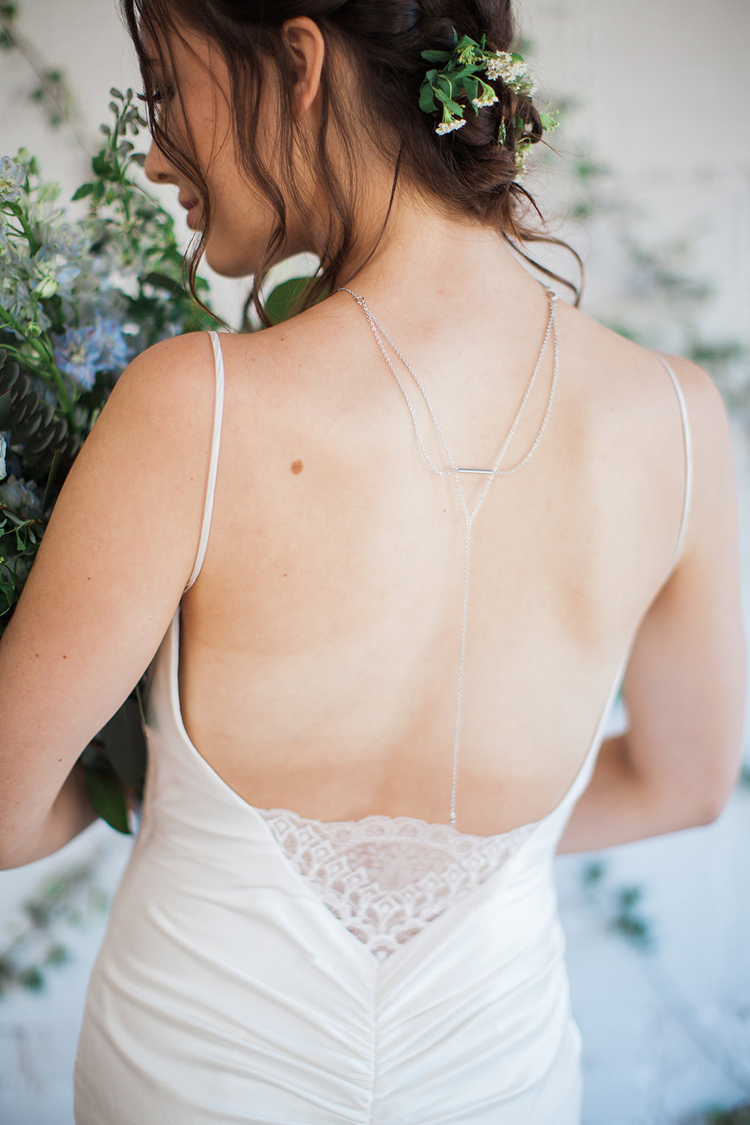 back necklaces with wedding dresses - photo by Natalie Bray Photography https://ruffledblog.com/french-provencal-wedding-inspiration-with-geometric-accents