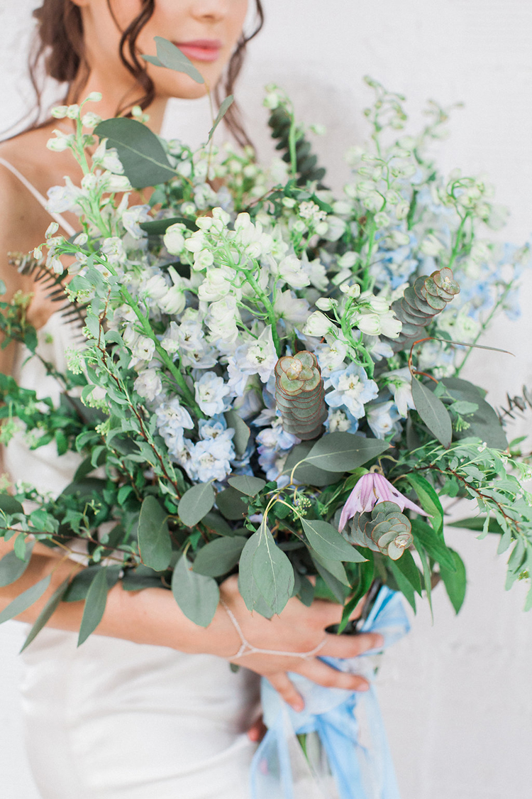 blue and green wedding bouquets - photo by Natalie Bray Photography https://ruffledblog.com/french-provencal-wedding-inspiration-with-geometric-accents