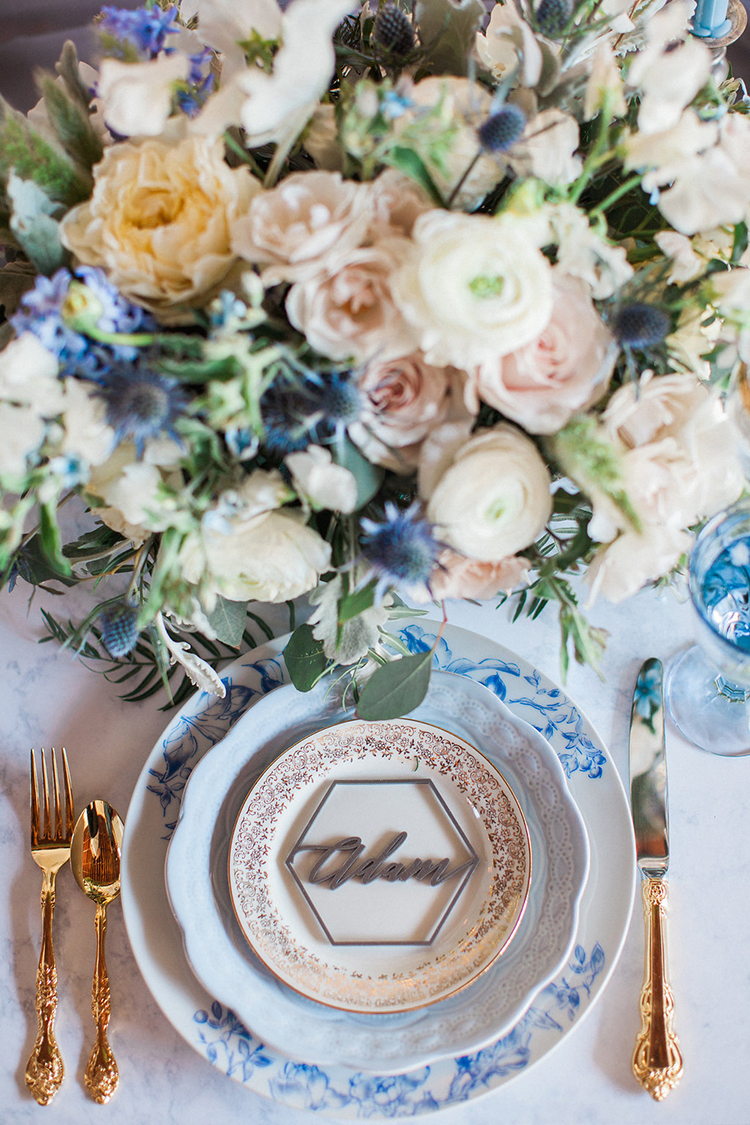 romantic floral table settings - photo by Natalie Bray Photography https://ruffledblog.com/french-provencal-wedding-inspiration-with-geometric-accents