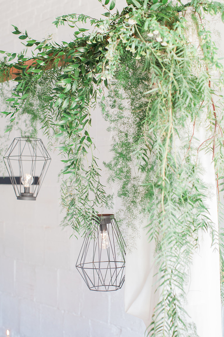 greenery details - photo by Natalie Bray Photography https://ruffledblog.com/french-provencal-wedding-inspiration-with-geometric-accents