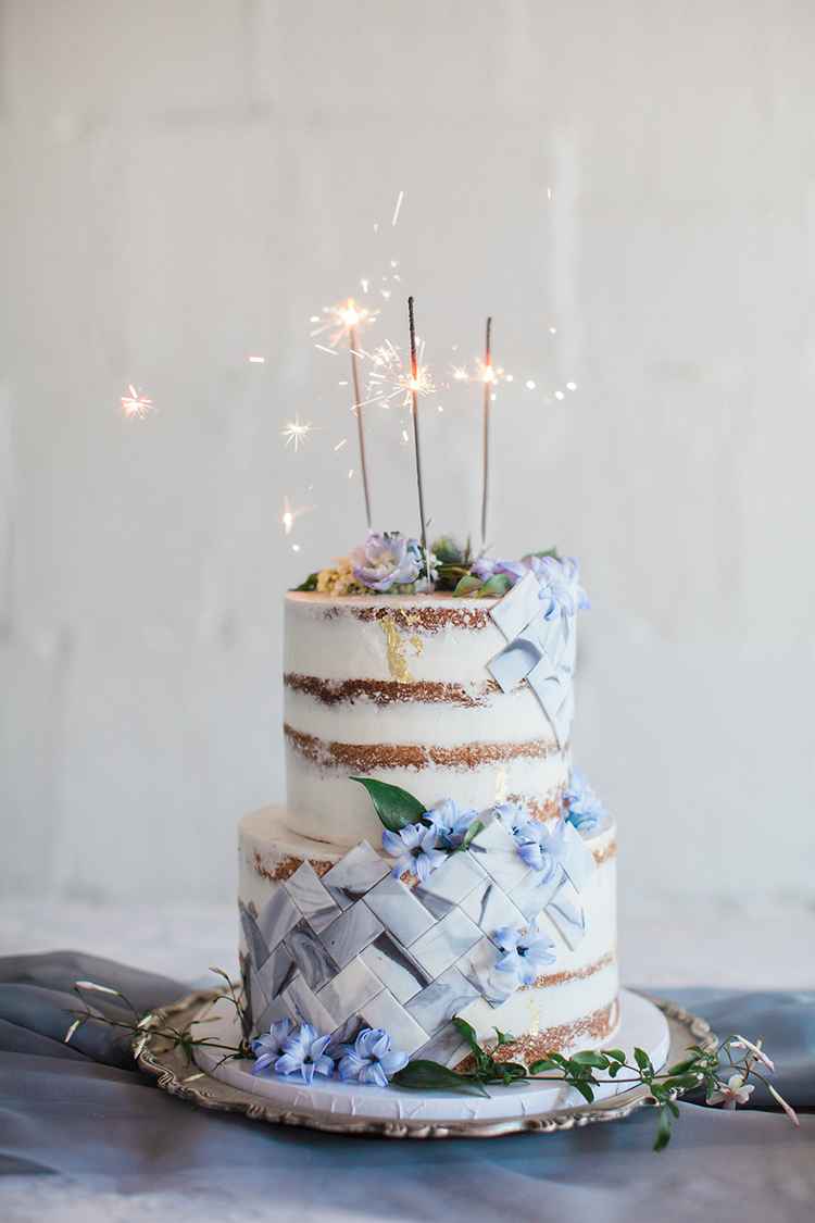wedding cakes with sparklers - photo by Natalie Bray Photography https://ruffledblog.com/french-provencal-wedding-inspiration-with-geometric-accents