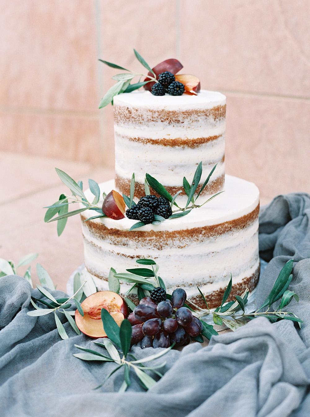 wedding cakes - photo by Melissa Jill http://ruffledblog.com/fruit-filled-vineyard-wedding-inspiration
