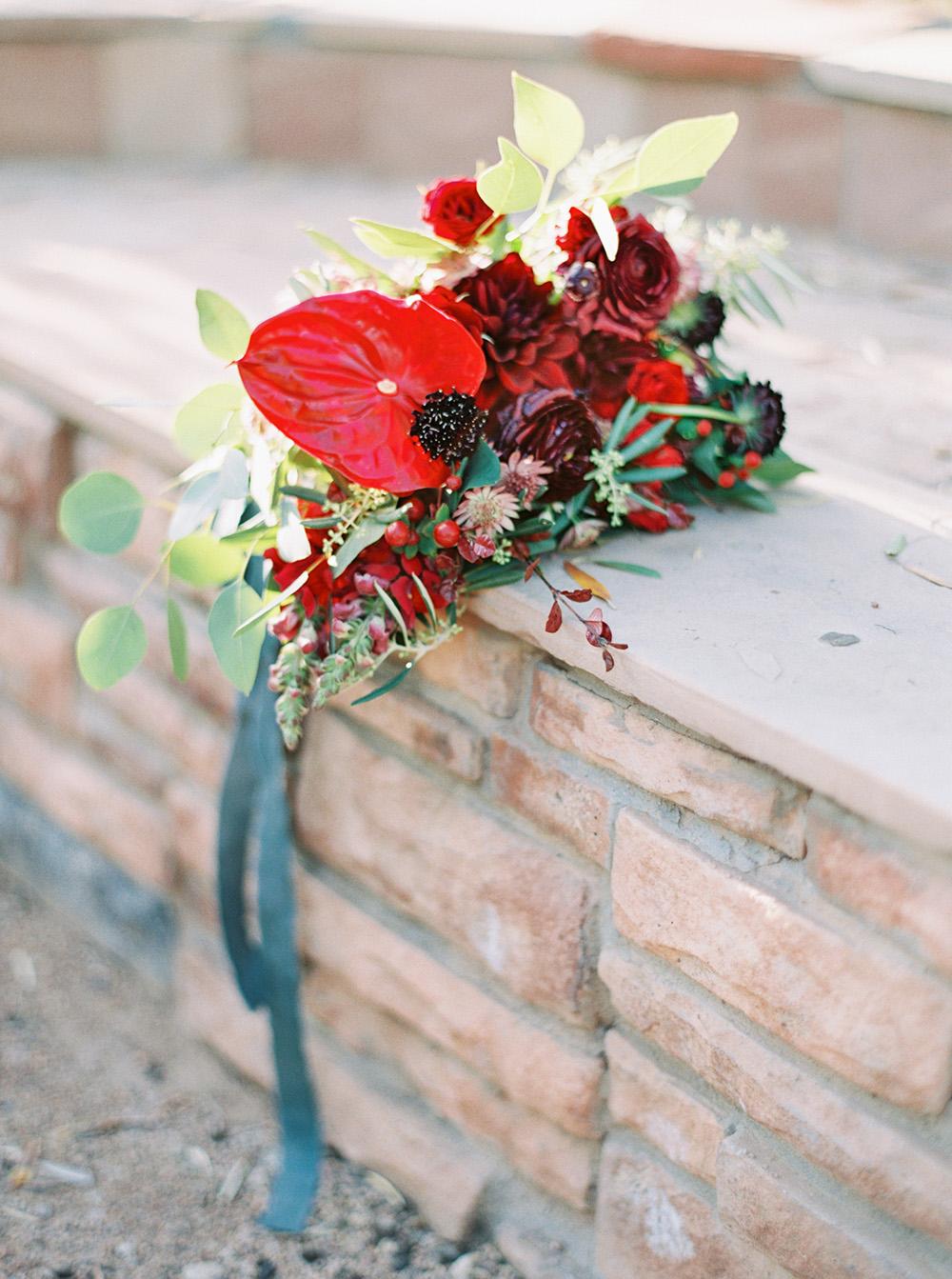 red bouquets - photo by Melissa Jill http://ruffledblog.com/fruit-filled-vineyard-wedding-inspiration