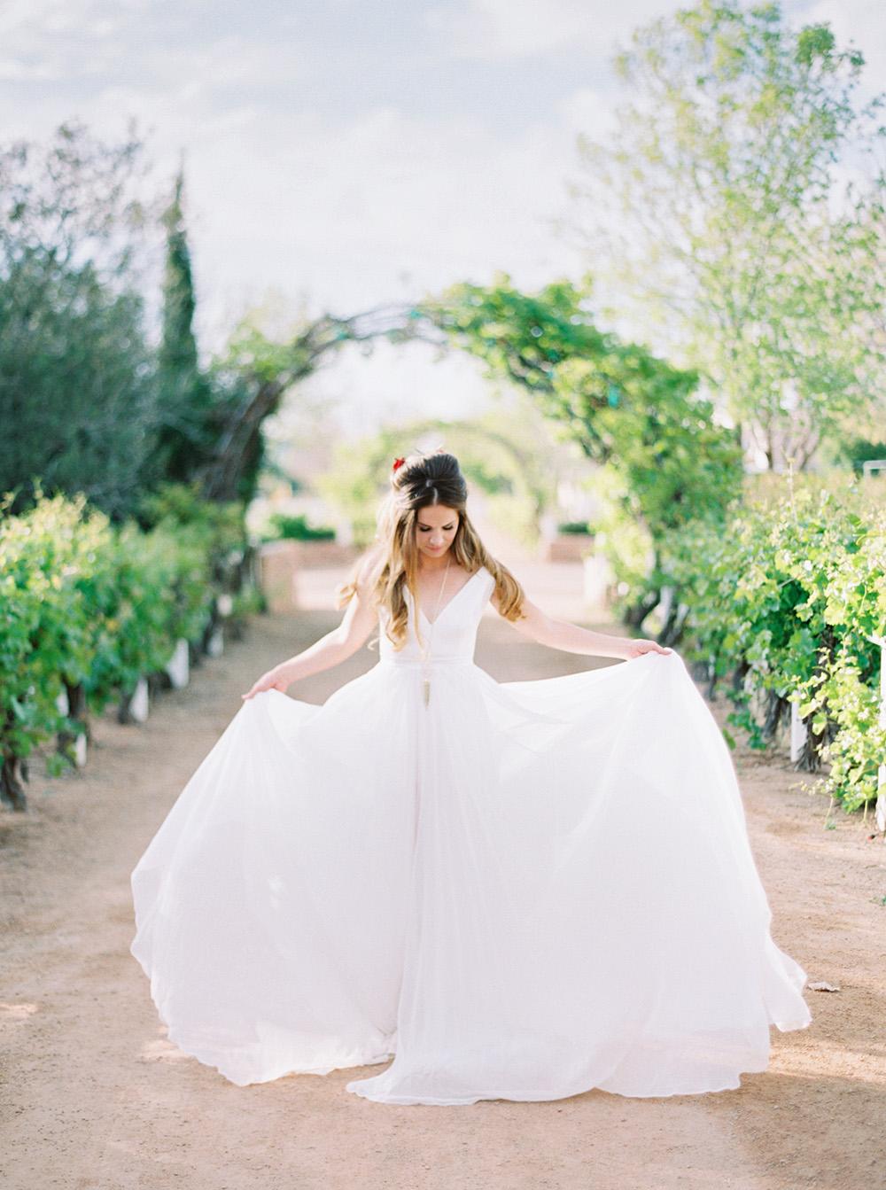 wedding dresses - photo by Melissa Jill http://ruffledblog.com/fruit-filled-vineyard-wedding-inspiration