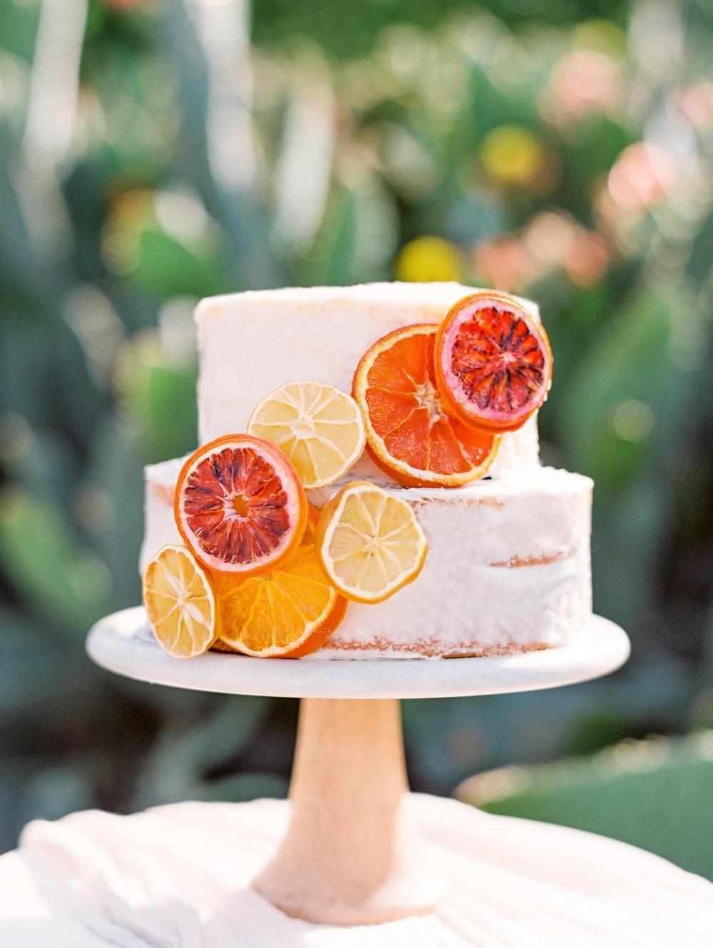 naked wedding cake with citrus