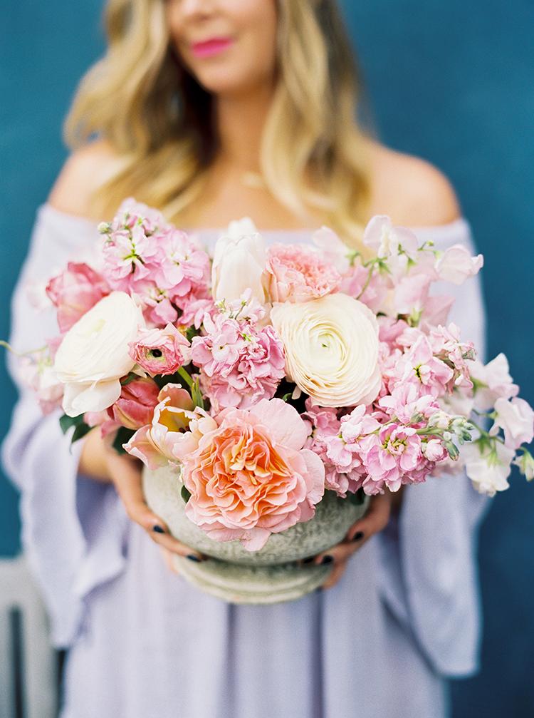 romantic floral arrangements - photo by Danielle Poff Photography http://ruffledblog.com/fun-and-flirty-bridal-shower-inspiration