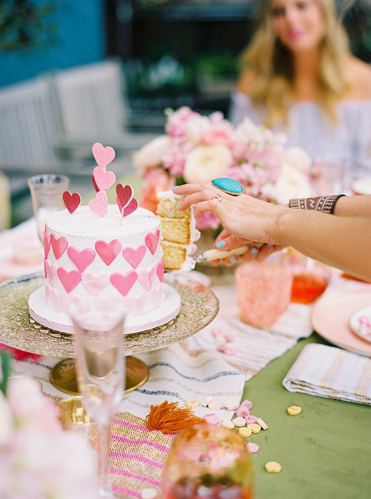 cake cutting - photo by Danielle Poff Photography http://ruffledblog.com/fun-and-flirty-bridal-shower-inspiration
