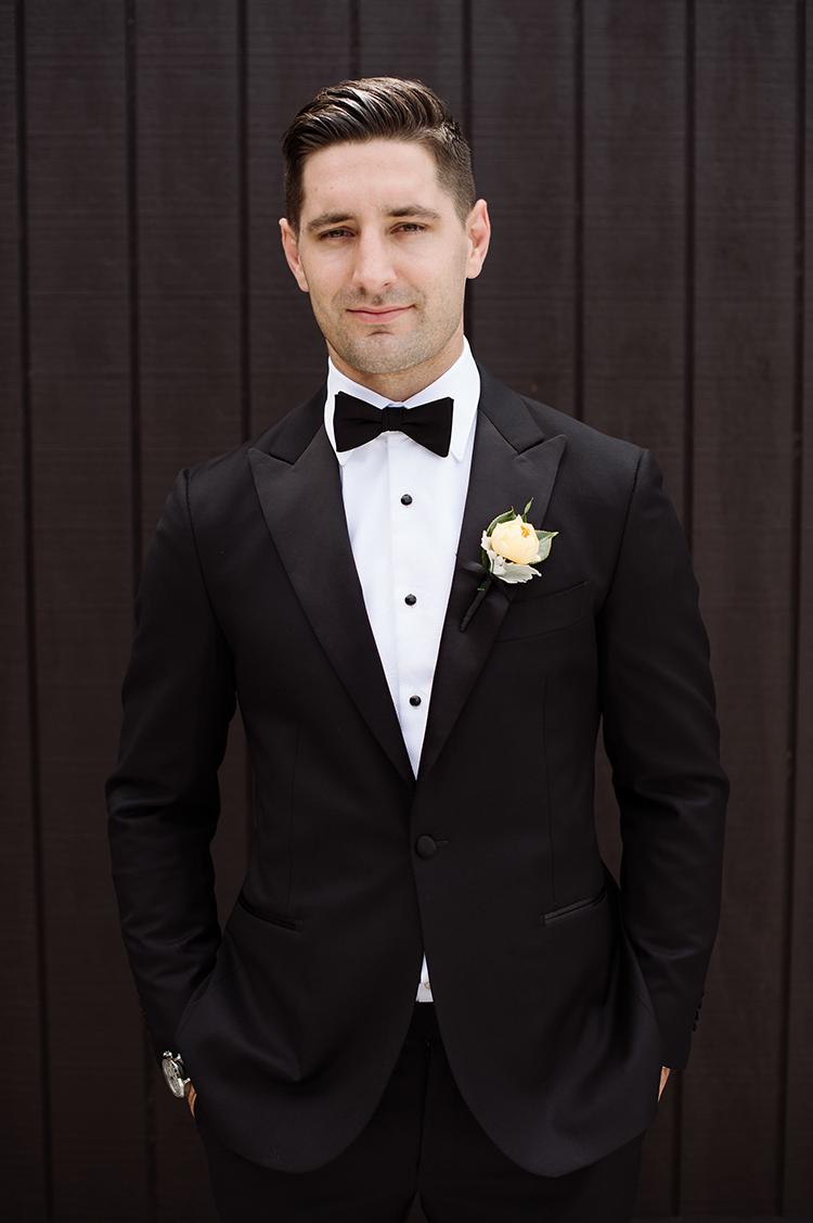 black tie groom fashion - photo by Jerome Cole http://ruffledblog.com/fun-black-tie-warehouse-wedding-in-melbourne