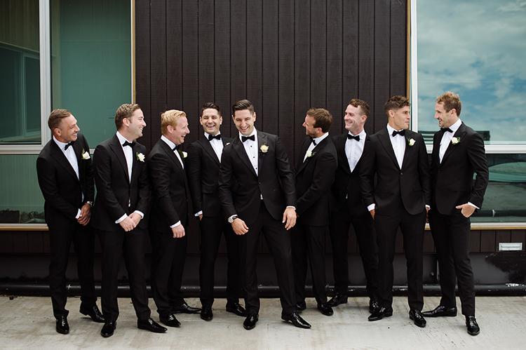 groomsmen in tuxedos - photo by Jerome Cole https://ruffledblog.com/fun-black-tie-warehouse-wedding-in-melbourne