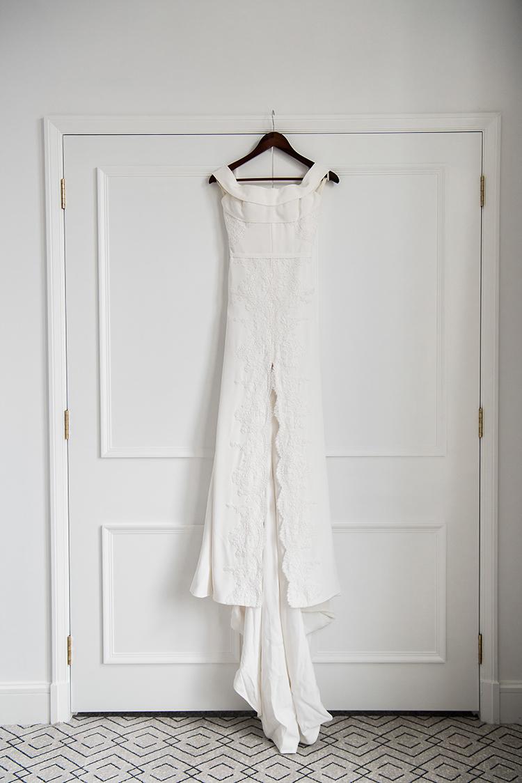 lace modern wedding dresses - photo by Jerome Cole http://ruffledblog.com/fun-black-tie-warehouse-wedding-in-melbourne