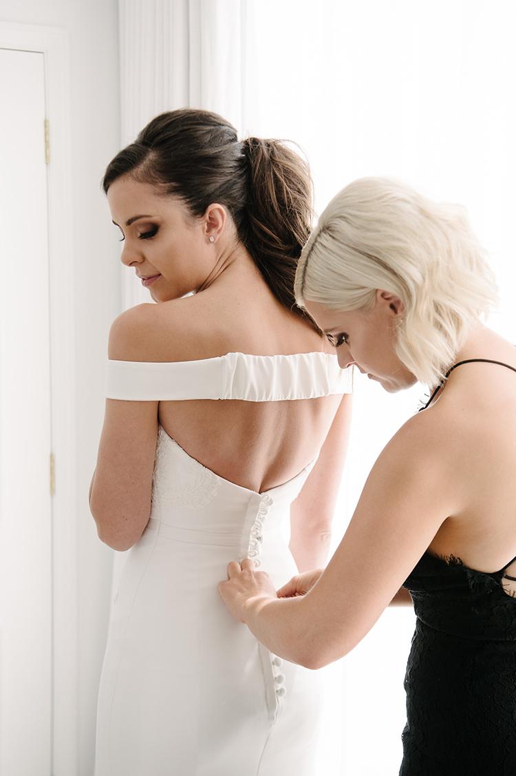 chic modern wedding dresses - photo by Jerome Cole http://ruffledblog.com/fun-black-tie-warehouse-wedding-in-melbourne