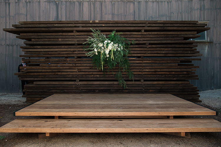 industrial inspired ceremony backdrops - photo by Jerome Cole https://ruffledblog.com/fun-black-tie-warehouse-wedding-in-melbourne